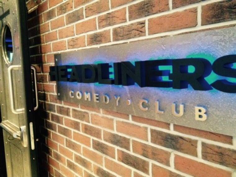 Headliner's Comedy Club entrance on board NCL Escape