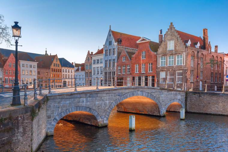 Bruges canal and bridge in the morning