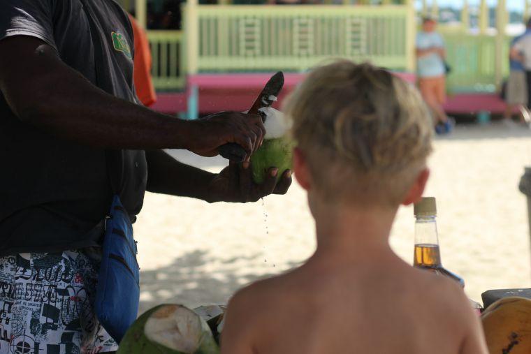 Coconut drink on a Caribbean beach, P&O Cruises family cruise in the caribbean