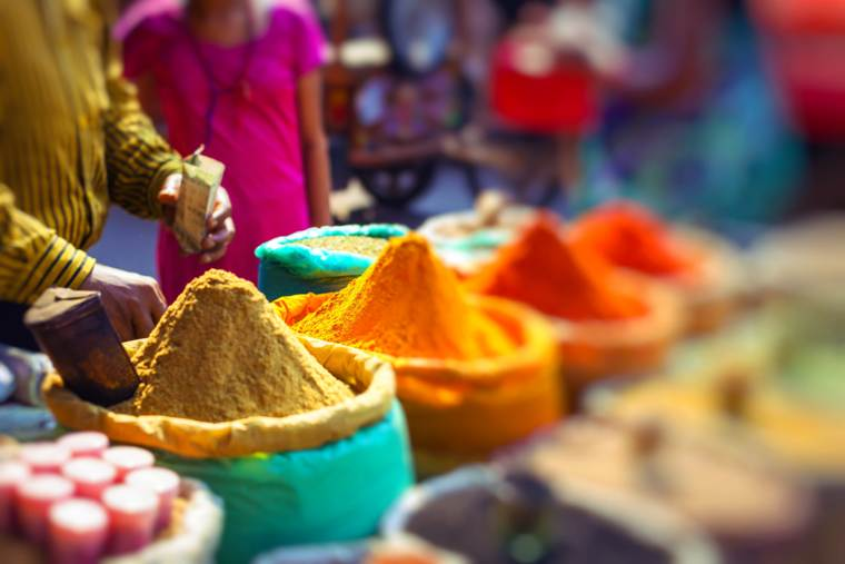 Colorful spices powders and herbs in traditional street market in Delhi. To be found when cruising in India.