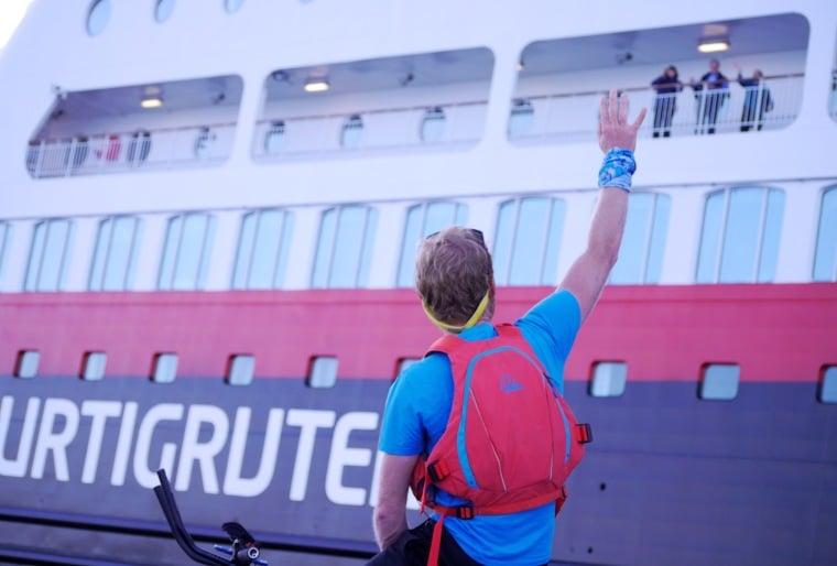 Dave Cornthwaite waving to guests on Hurtigruten