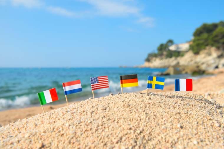 European beach with row little flags