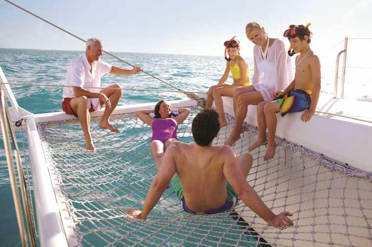 Family relaxing on board Celebrity Silhouette's catamaran