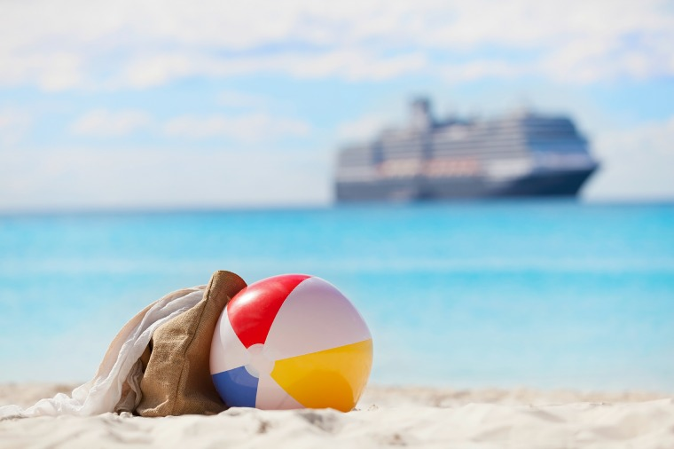 Beach with a cruise ship in the background