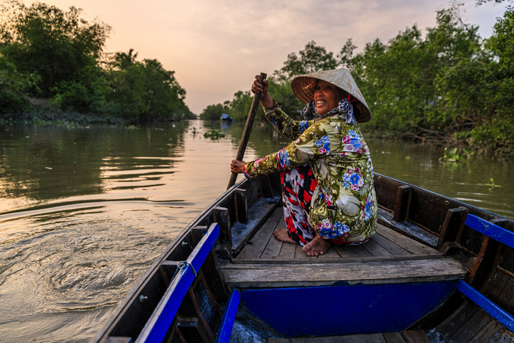 Woman rowing on the Mekong River