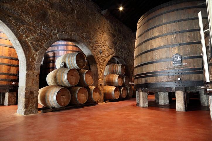 Old fashioned Porto wine cellar with wooden barrels in Porto, Portugal