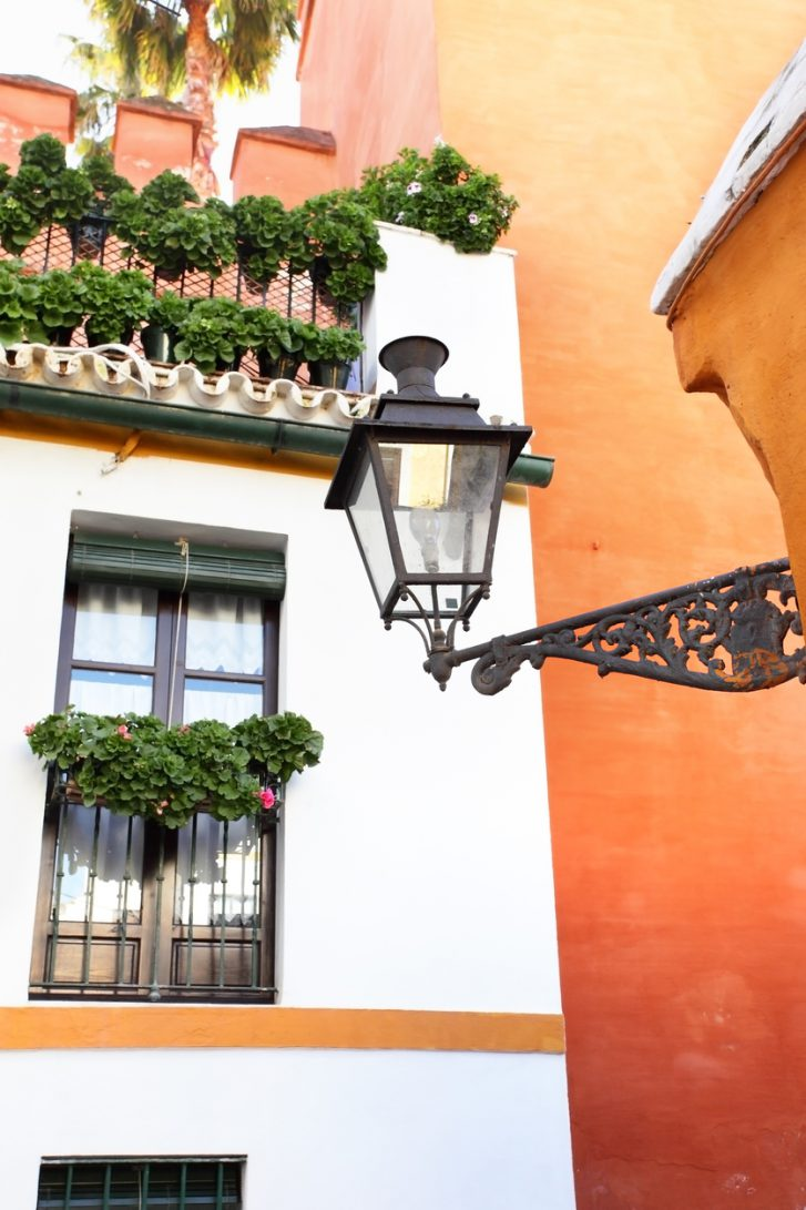 Old street and lamp in Seville