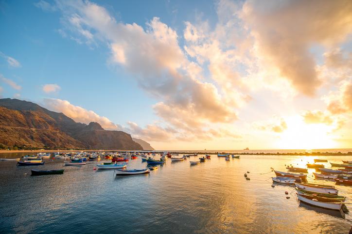 Fishing boats on Teresitas beach on the sunrise on Tenerife island, Spain