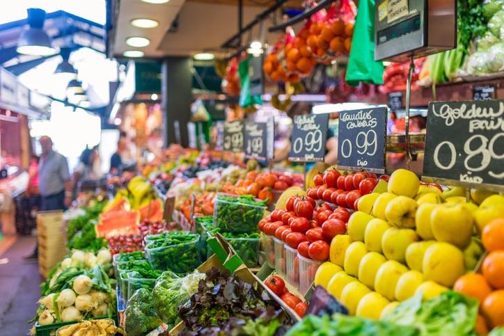 Price tags on market stall, fruits and vegetables for sale at La Boqueria. La Boqueria is a large public market in the Ciutat Vella district of Barcelona, Catalonia, Spain