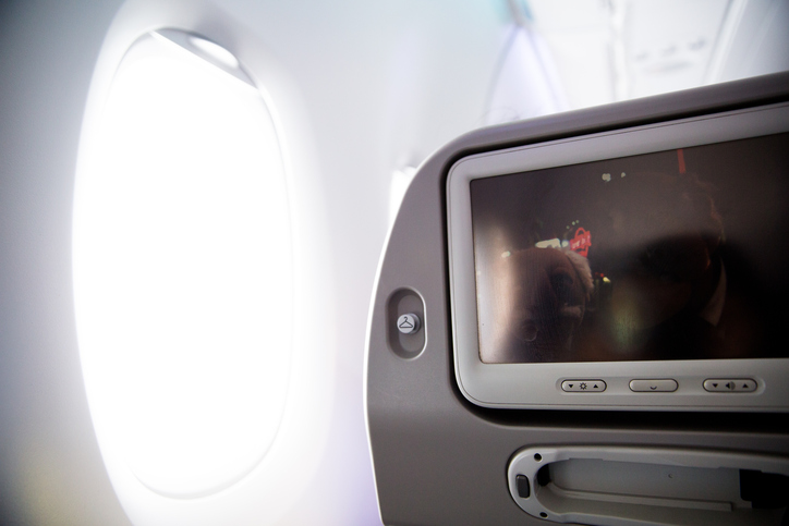 the window seat on the plane and tv screen