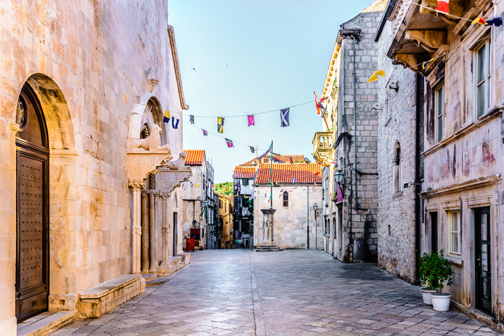 Main square view in old city center of town Korcula, famous travel destination in Croatia, Europe.