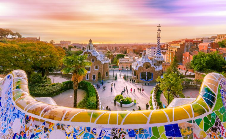 View of the city from Park Guell in Barcelona, Spain with moving clouds.