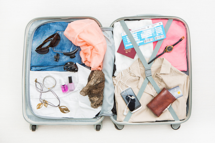 suitcase full of clothes, travelling