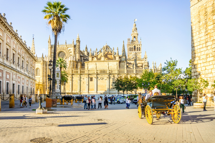 Cathedral of Saint Mary of the See with horse carriage, Seville, Spain