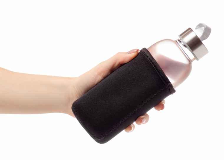 Reusable water bottle in hand