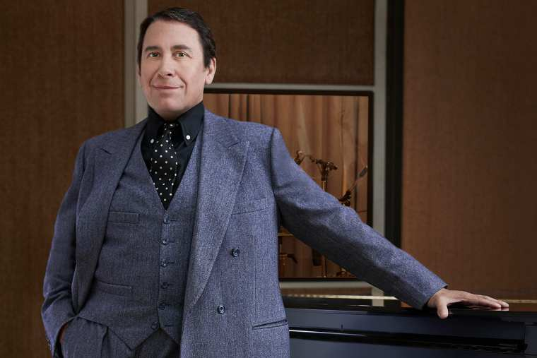 Jools Holland standing at the piano - photo by Mary McCartney