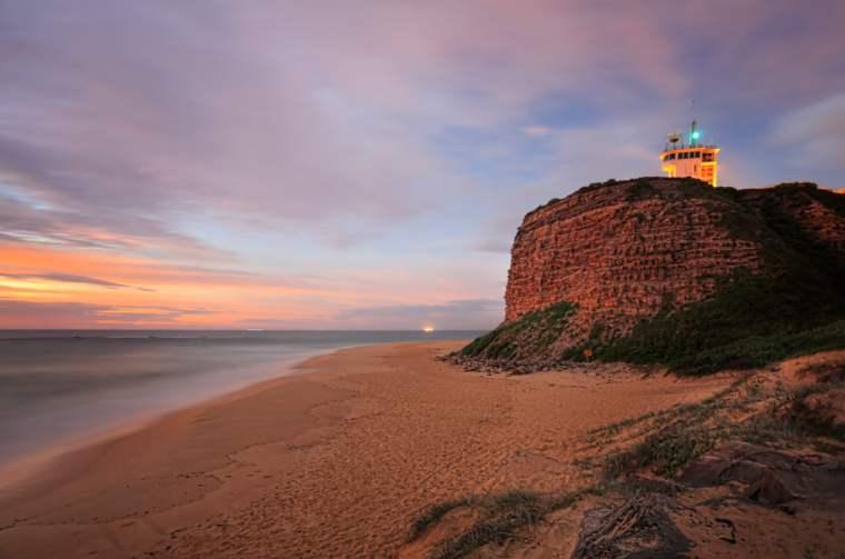 Nobbys Lighthouse in Newcastle, Australia, with sunrise sky
