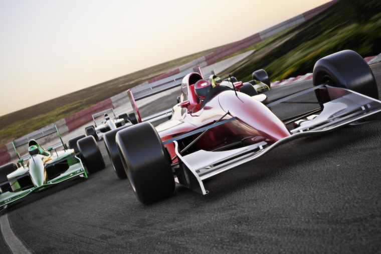 Racing cars on a race track
