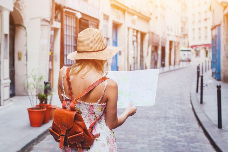 Tourist with a map in Europe