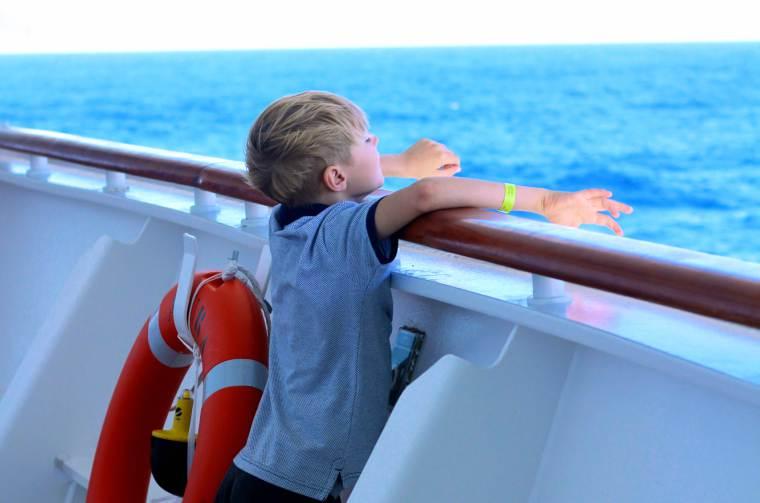 William peering over the edge of Azura, P&O Cruises Azura, kids on board a cruise ship