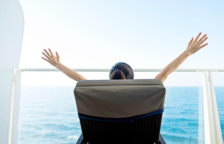 woman sat on a cruise ship balcony