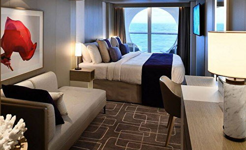 Deluxe Ocean View Stateroom with Balcony – [1B]