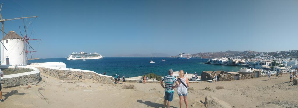 Jewel of the Seas anchored outside Mykonos Old Port. Celebrity Edge cruise ship is also at anchor in the bay