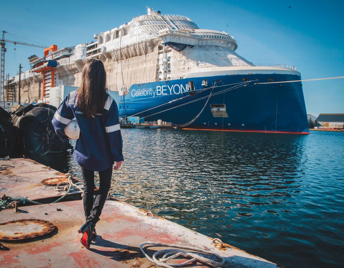 Captain Kate McCue, the first American female cruise ship captain, watches as construction continues on Celebrity Beyond at the Chantiers de l'Atlantique shipyard in Saint-Nazaire, France